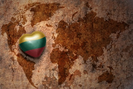 lithuanian: heart with national flag of lithuania on a vintage world map crack paper background. concept Stock Photo