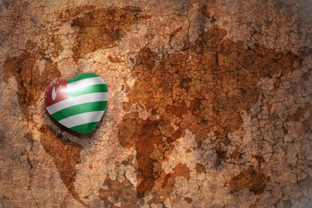 middle east peace: heart with national flag of abkhazia on a vintage world map crack paper background. concept