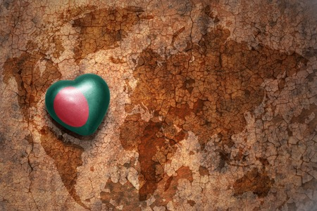middle east peace: heart with national flag of bangladesh on a vintage world map crack paper background. concept Stock Photo