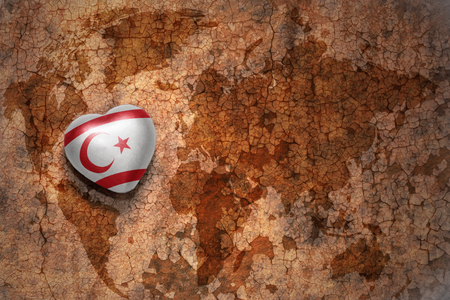 middle east peace: heart with national flag of northern cyprus on a vintage world map crack paper background. concept
