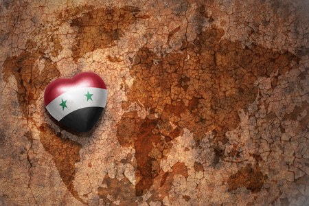 middle east peace: heart with national flag of syria on a vintage world map crack paper background. concept Stock Photo