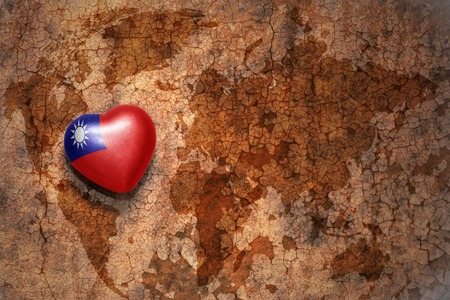 middle east peace: heart with national flag of taiwan on a vintage world map crack paper background. concept