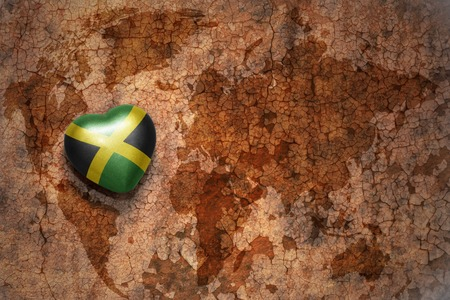 Heart with national flag of puerto rico on a vintage world map heart with national flag of jamaica on a vintage world map crack paper background concept gumiabroncs Images