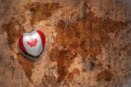Heart with national flag of canada on a vintage world map crack heart with national flag of canada on a vintage world map crack paper background concept gumiabroncs Choice Image