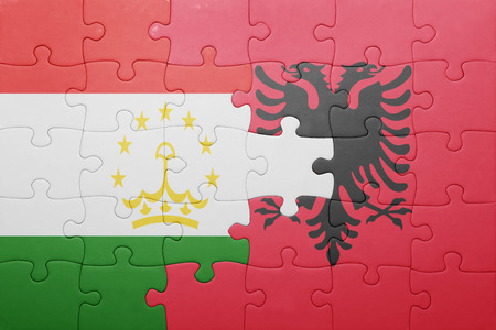 economy of tajikistan: puzzle with the national flag of tajikistan and albania . concept Stock Photo