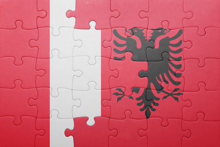 lima region: puzzle with the national flag of peru and albania . concept