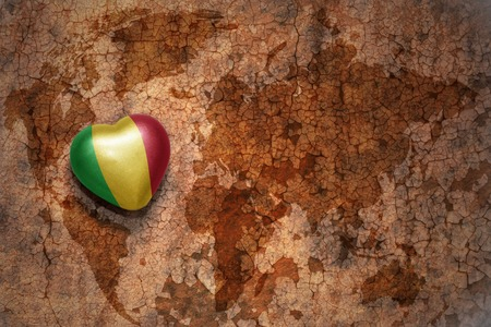 bamako: heart with national flag of mali on a vintage world map crack paper background. concept