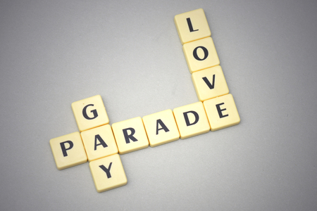 gay parade: words gay and parade on a gray background. concept
