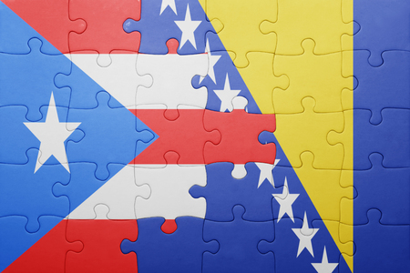 bandera de puerto rico: puzzle with the national flag of bosnia and herzegovina and puerto rico . concept