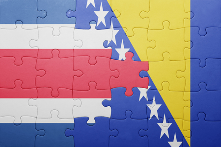 costa rican flag: puzzle with the national flag of bosnia and herzegovina and costa rica . concept