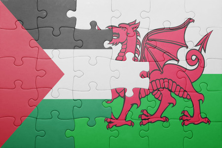 palestine: puzzle with the national flag of wales and palestine . concept Stock Photo