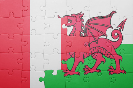 lima region: puzzle with the national flag of wales and peru . concept Stock Photo