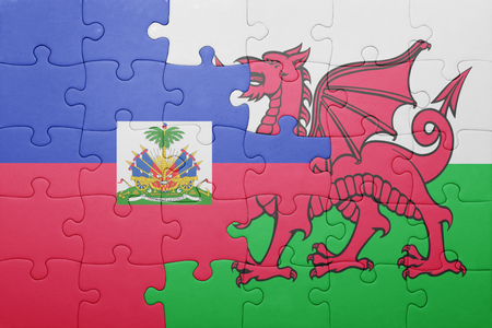 port au prince: puzzle with the national flag of wales and haiti . concept