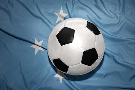 federated: vintage black and white football ball on the national flag of Federated States of Micronesia