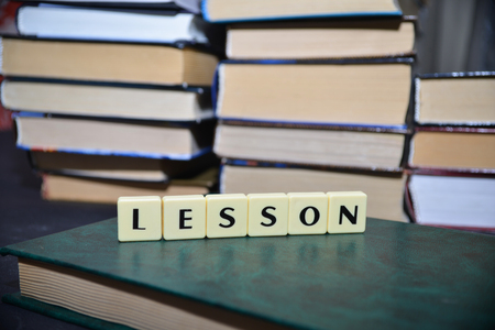 erudition: word lesson near the pile of books. education concept