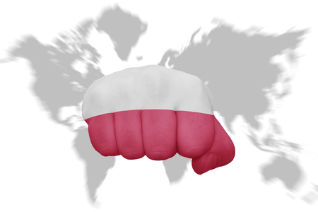 nationalism: fist with the national flag of poland on a world map background