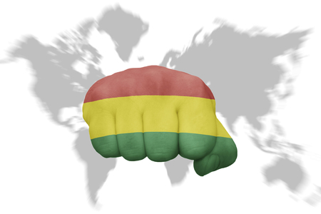 mapa de bolivia: fist with the national flag of bolivia on a world map background