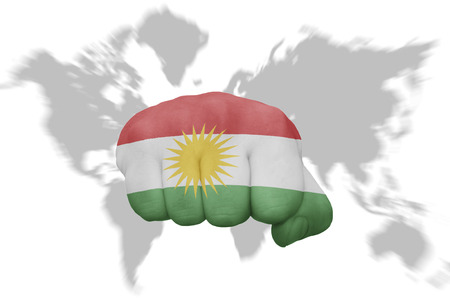 fist with the national flag of kurdistan on a world map background