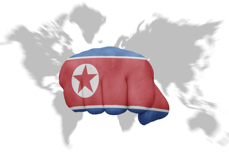fist with the national flag of north korea on a world map background Stock Photo