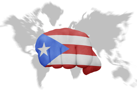 fist with the national flag of puerto rico on a world map background