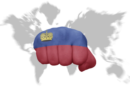 Fist With The National Flag Of Liechtenstein On A World Map