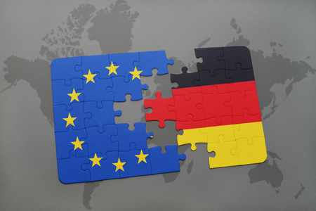 scepticism: puzzle with the national flag of germany and european union on a world map background.