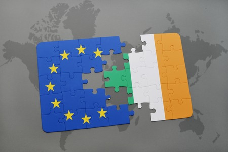 scepticism: puzzle with the national flag of ireland and european union on a world map background. Stock Photo
