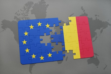 scepticism: puzzle with the national flag of romania and european union on a world map background. Stock Photo