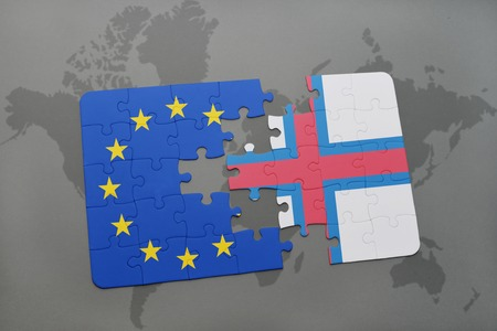 scepticism: puzzle with the national flag of faroe islands and european union on a world map background.