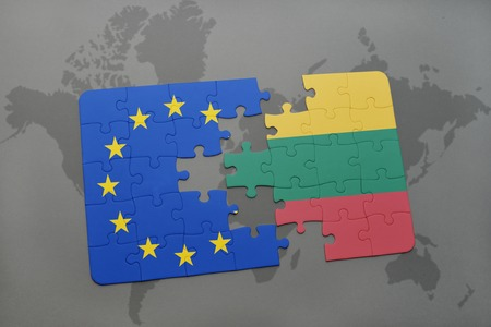 european union flag: puzzle with the national flag of lithuania and european union on a world map background.