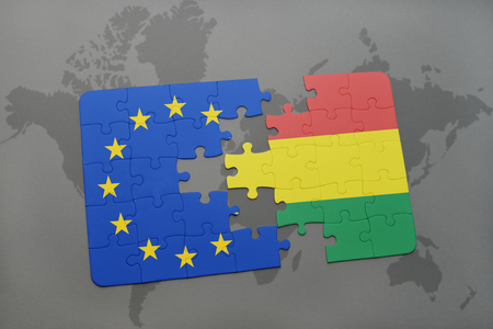mapa de bolivia: puzzle with the national flag of bolivia and european union on a world map