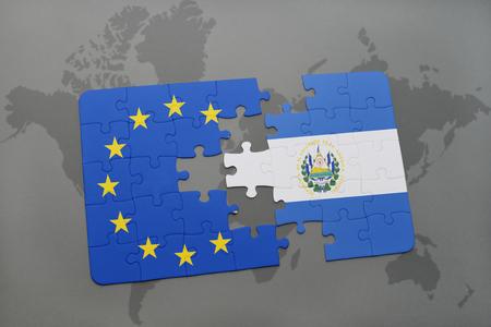 mapa de el salvador: puzzle con la bandera nacional de El Salvador y la Uni�n Europea sobre un mapa del mundo