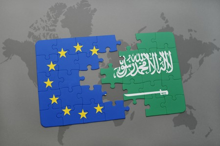 middle east crisis: puzzle with the national flag of saudi arabia and european union on a world map Stock Photo