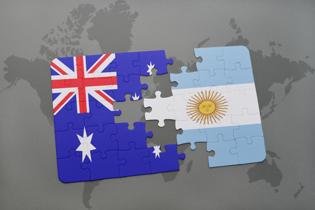 separatism: puzzle with the national flag of australia and argentina on a world map background.3D illustration