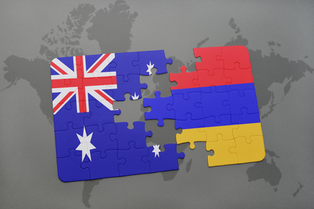 separatism: puzzle with the national flag of australia and armenia on a world map background.