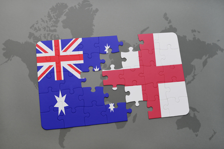 separatism: puzzle with the national flag of australia and england on a world map background. Stock Photo