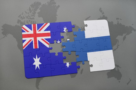 separatism: puzzle with the national flag of australia and finland on a world map background.