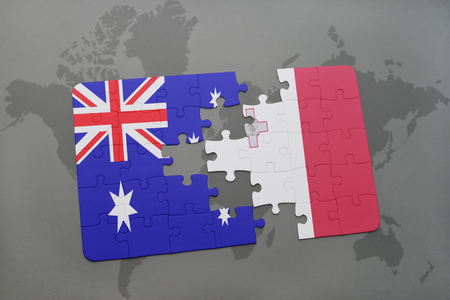 separatism: puzzle with the national flag of australia and malta on a world map background. Stock Photo