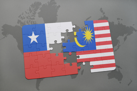 separatism: puzzle with the national flag of chile and malaysia on a world map background. 3D illustration Stock Photo