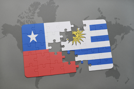 separatism: puzzle with the national flag of chile and uruguay on a world map background. 3D illustration Stock Photo