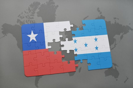 separatism: puzzle with the national flag of chile and honduras on a world map background. 3D illustration Stock Photo