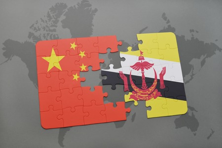 map of brunei: puzzle with the national flag of china and brunei on a world map background. 3D illustration