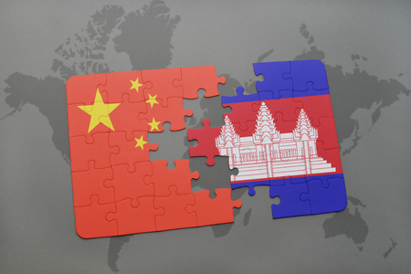 cambodian: puzzle with the national flag of china and cambodia on a world map background. 3D illustration Stock Photo