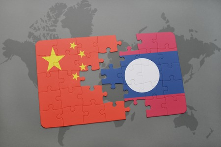 separatism: puzzle with the national flag of china and laos on a world map background. 3D illustration