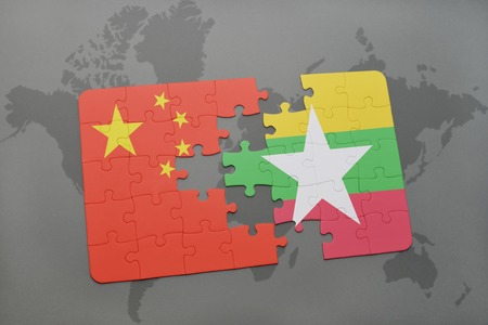 puzzle with the national flag of china and myanmar on a world map background. 3D illustration