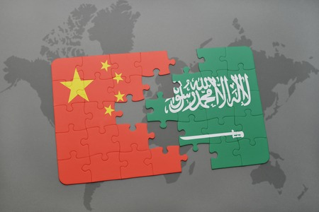 separatism: puzzle with the national flag of china and saudi arabia on a world map background. 3D illustration