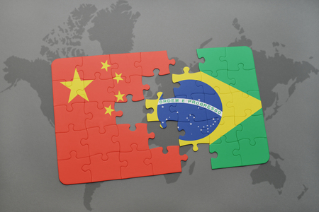 puzzle with the national flag of china and brazil on a world map background. 3D illustration