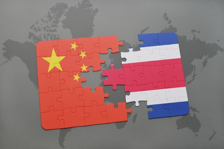 rican: puzzle with the national flag of china and costa rica on a world map background. 3D illustration Stock Photo