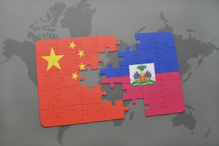 middle east crisis: puzzle with the national flag of china and haiti on a world map background. 3D illustration Stock Photo
