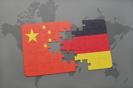 east berlin: puzzle with the national flag of china and germany on a world map background. 3D illustration